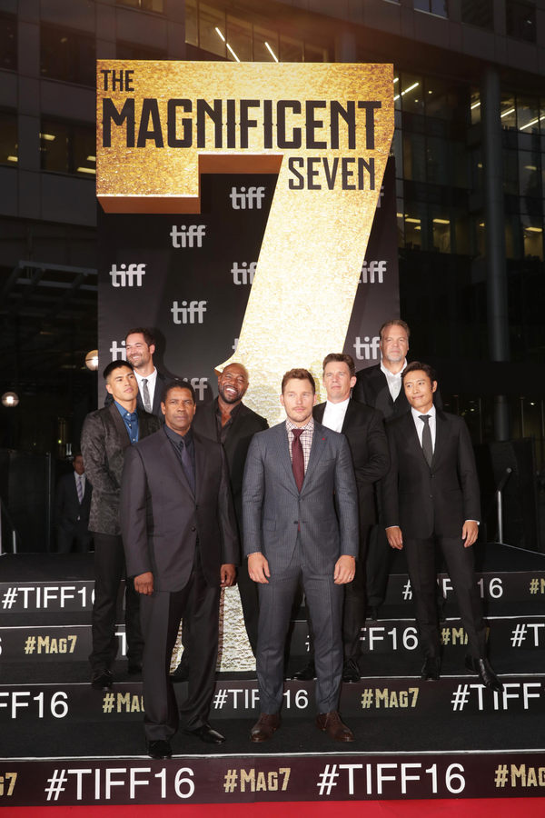 """Martin Sensmeier, Manuel Garcia-Rulfo, Denzel Washington, Director Antoine Fuqua, Chris Pratt, Ethan Hawke, Vincent D'Onofrio and Byung-hun Lee seen at MGM and Columbia Pictures' world premiere and opening night screening of """"The Magnificent Seven"""" at the 2016 Toronto International Film Festival on Thursday, Sep. 8, 2016, in Toronto, CAN."""