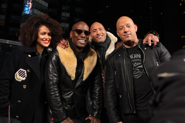 """- New York, NY - 12/11/16 - The Cast of """"The Fate of The Furious"""" Present the Film's Trailer Launch in Times Square. -Pictured: Nathalie Emmanuel, Tyrese Gibson, Dwayne Johnson, Vin Diesel -Photo by: Marion Curtis/Starpix -Location: Marriot Marquis in Times Square."""