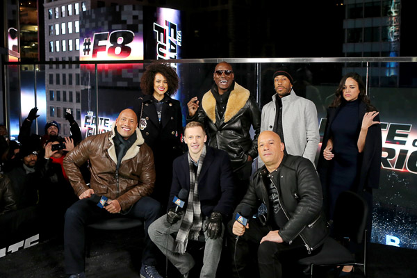 """- New York, NY - 12/11/16 - The Cast of """"The Fate of The Furious"""" Present the Film's Trailer Launch in Times Square. -Pictured: Dwayne Johnson, Nathalie Emmanuel, Liam McHugh (NBC Sports), Tyrese Gibson, Vin Diesel, Ludacris, Michelle Rodriguez -Photo by: Marion Curtis/Starpix -Location: Marriot Marquis in Times Square."""